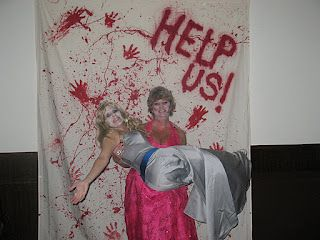 Zombie Prom picture backdrop. White sheet/ red paint.