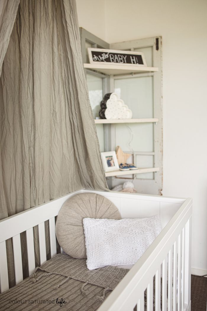 Gray fabric draped over a white crib with gray and white for Retro nursery fabric