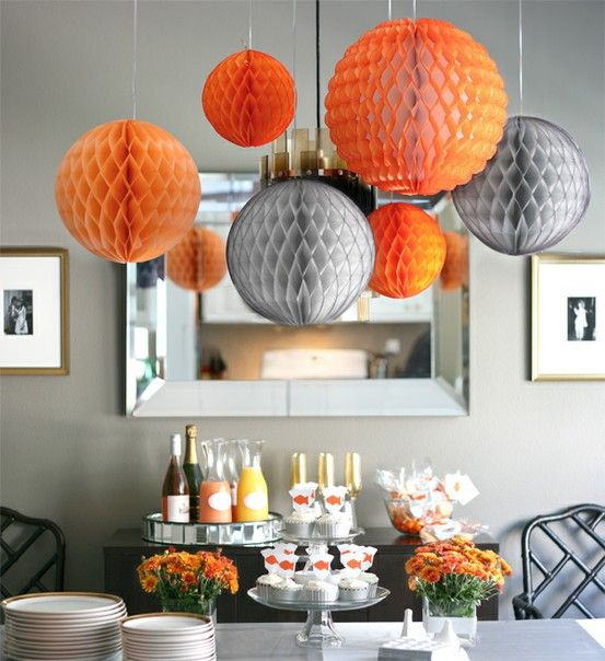 Cool party decorating idea.  Can make the paper balls Christmas colors with bows attached to top....like hanging ornaments.