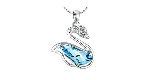NEVI Swan Animal Fashion Swarovski Elements Rhodium Plated Matinee  Pendant Necklace Jewellery for Women & Girls (Blue & Silver) - Buy from Amazon MRP: Rs 5900 Discount: 77% Off Buy Price: Rs 1350