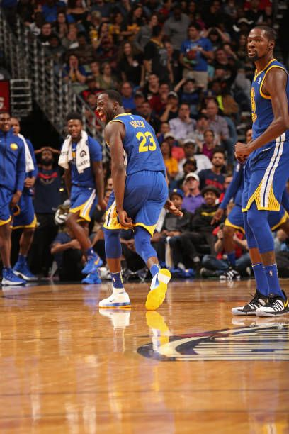 Draymond Green of the Golden State Warriors celebrates and runs up the court on December 4 2017 at Smoothie King Center in New Orleans Louisiana NOTE...