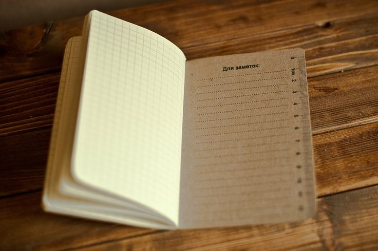 notebook with printing company logo
