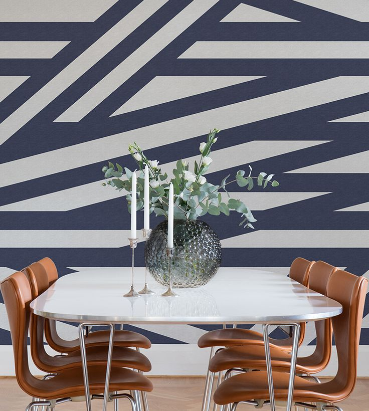 A striped geometric wallpaper pattern in white and a dark blue, with the base of a beautiful linen structure. The lines of the wallpaper continue for all eternity and the design works magic when used on more than one wall!