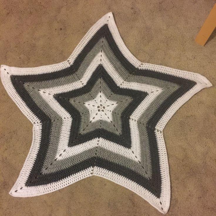 Crocheted star blanket  White, light grey and dark grey using marvel yarn.
