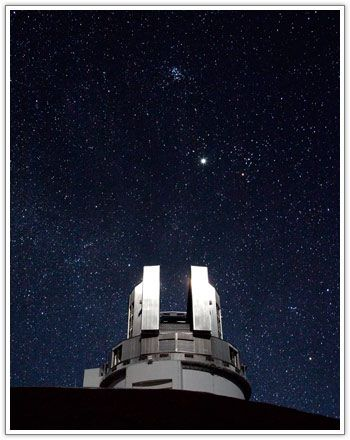 The Pleiades star cluster and Jupiter above Subaru Telescope's dome