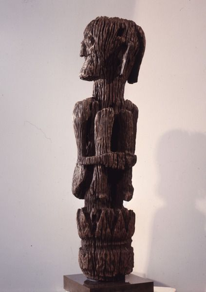 A male figure rising from a tree