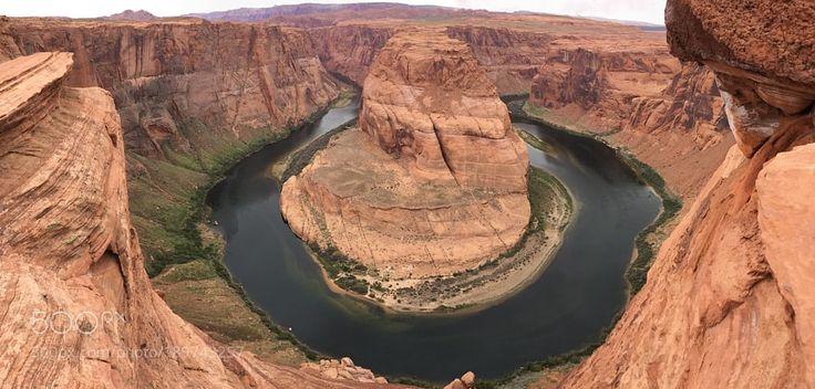 http://500px.com/photo/189743257 Horseshoe by mehmetyukselphotography -Horseshoe Bend is a horseshoe-shaped meander of the Colorado River located near the town of Page Arizona in the United States.. Tags: parkskylandscapesunriselakeseasunsetmountainswaternatureriverbeachtravelbluesunlightcloudsoceanrockroadrockssummerlifephotosandarizonavalleydesertcanyonravineoutdoorsdamsandstonepagetraditionalantelope canyonscenichorseshoeremotegeologyreservoircoconino countyno person