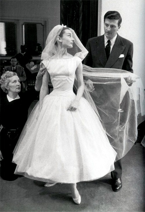 Audrey Hepburn being fitted by Givenchy for 'Funny Face' 1957