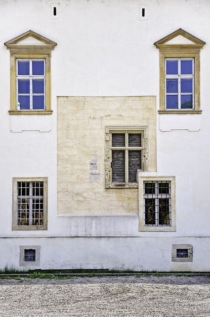 Several windows on a white wall, Alba Iulia, Romania