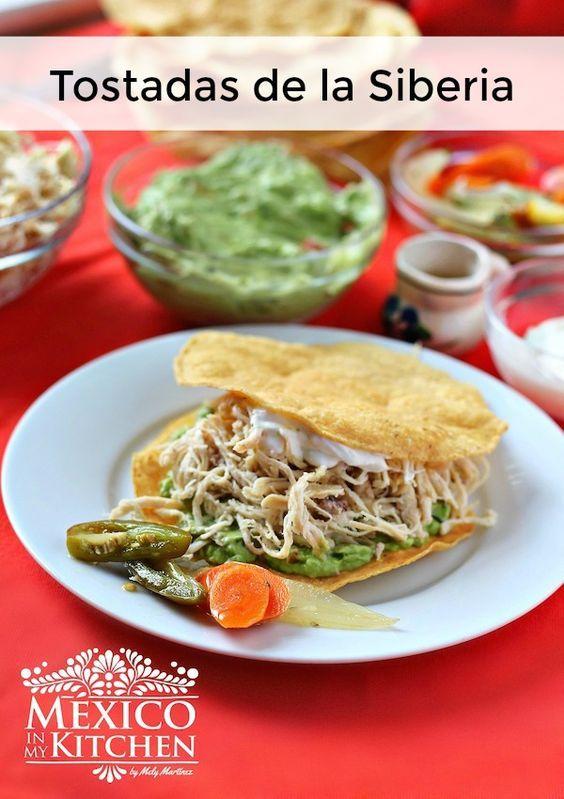 Flavorful seasoned shredded chicken breast layered between creamy guacamole and corn tostadas. Check the recipe: http://www.mexicoinmykitchen.com/2016/08/tostadas-de-la-siberia.html