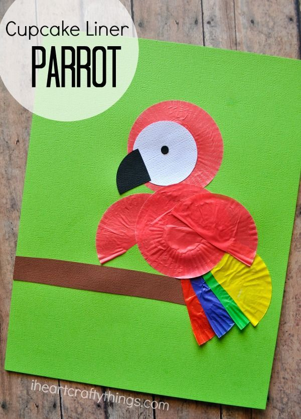 Children will love making a Cupcake Liner Parrot Kids Craft. Great craft after learning about birds or the rain forest.