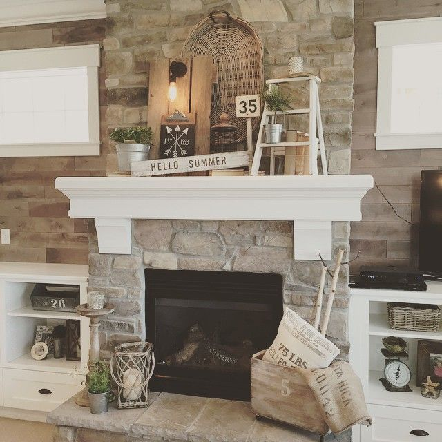 Living Room decor - rustic farmhouse style featuring stone clad fireplace,  large chunky white wood mantel, built-in shelving on either side of the  fireplace ...