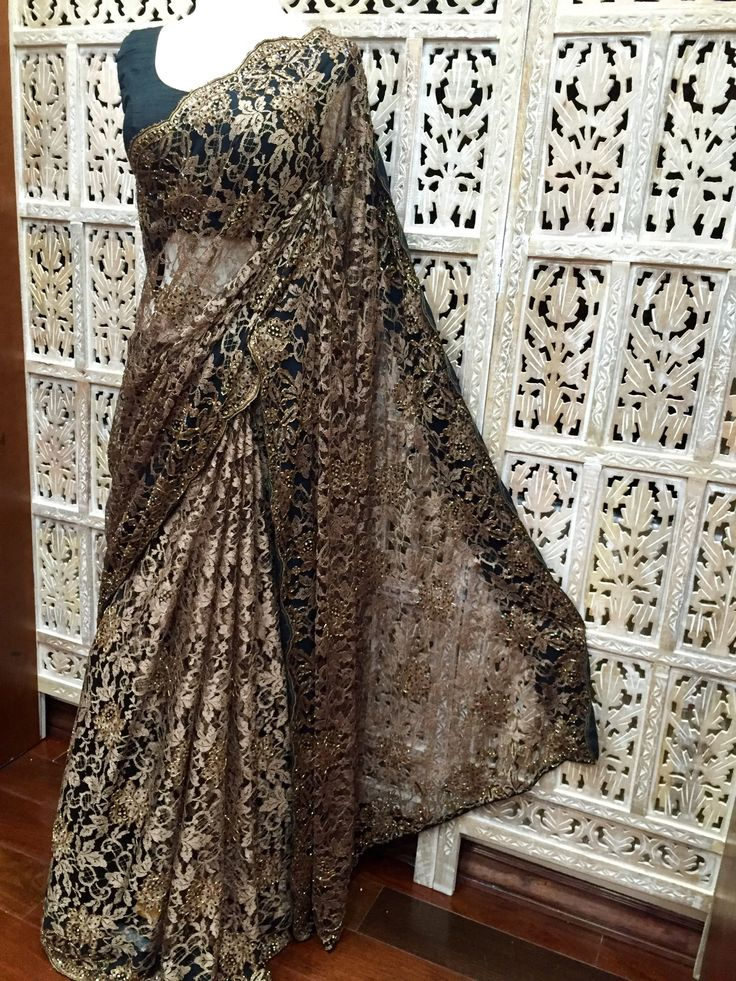 Antique gold and black dual tone French Chantilly lace saree embellished with crystal, beads and sequins. Custom orders available in a choice of colors. www.riitifashions.com 408-368-8486
