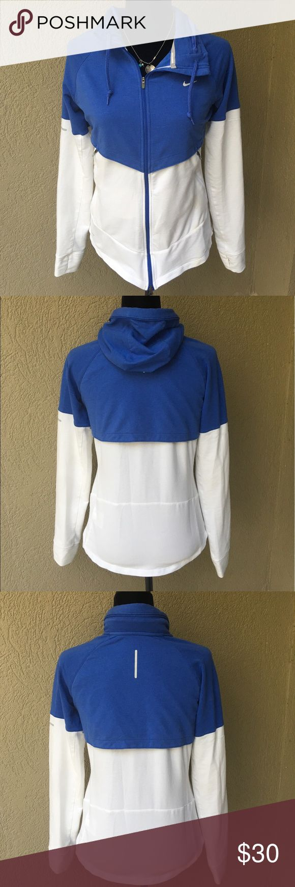 """Nike Dri-fit Running Jacket PRICE FIRM Nike Dri-fit runners jacket- this jacket has all the necessities! Wear w/hood out OR zip in in so you don't have good, loose Fri-fit web beneath the blue color to help with air flow, front zippers in front, thumb holes, also has a a double zipper up the front, great curved hem! EUC no holes but there is one stain on the left front pocket that will likely come out I just don't use any pretreat or chemicals when I wash. 18"""" Bust 23.5 length ✅I ship same…"""