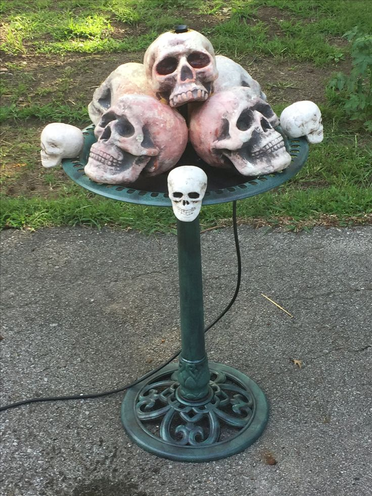 My updated skull fountain made with craft store skulls, a plastic bird bath I got off of eBay and a garden pond pump I purchased at my local home improvement store.
