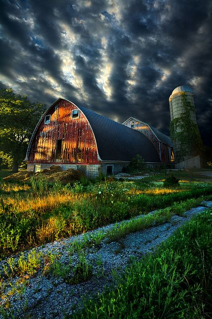 Beautiful.. I love old barns.  And the lighting in the sky is amazing.