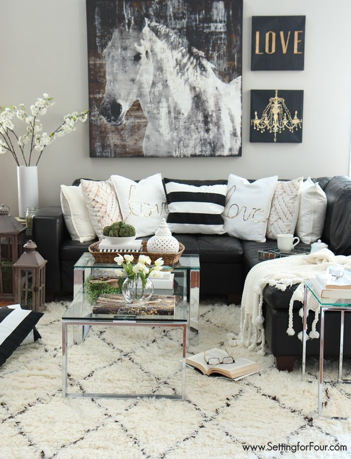 Living room decor ideas. Black, white and creamy neutrals with a pop of green!