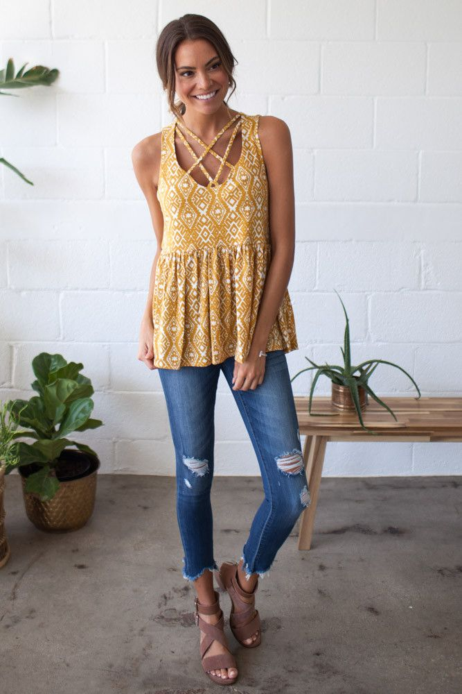 Bohme's Golden State of Mind Tank features a cage chest detailing, a mustard aztec print, and a soft peplum.