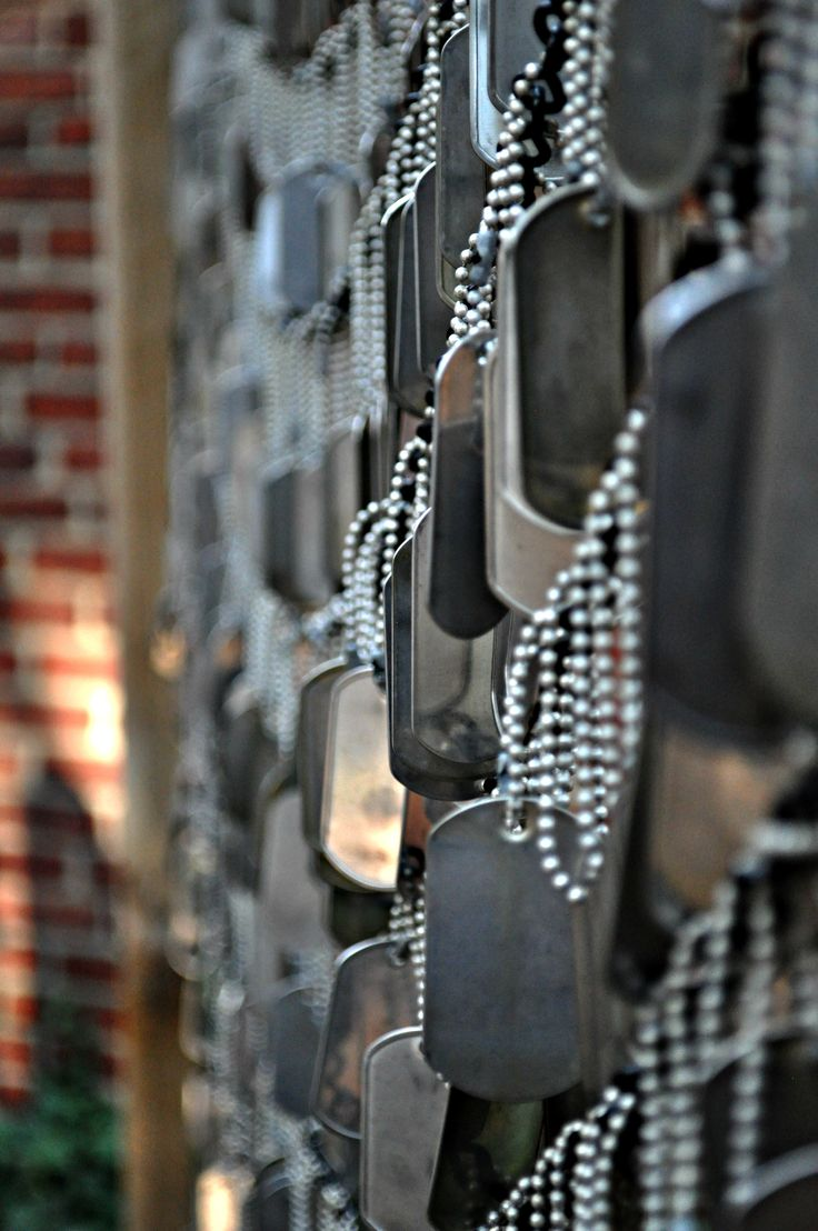 Boston, Located on the south side of the Old North Church stands a small area set aside to commemorate the soldiers lost in the Afghanistan and Iraq Wars. Hundreds of dog tags representing the fallen soldiers from these conflicts hang closely together. When the wind blows one can hear the distinctive metal chimes as they clang together to make their eery music. ---- I don't think I'd be able to handle seeing this in real life. It breaks me...