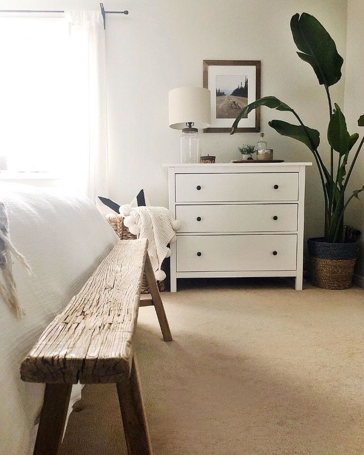 Old world bench at the end of the bed, white and w…