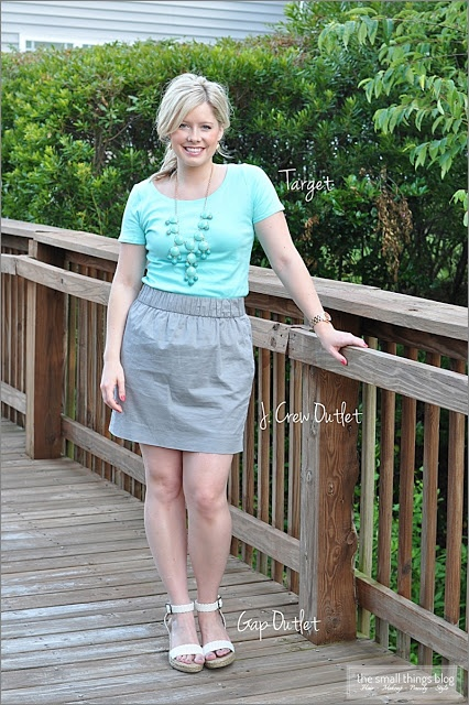 Teal t-shirt, statement necklace, gray skirt, white wedges