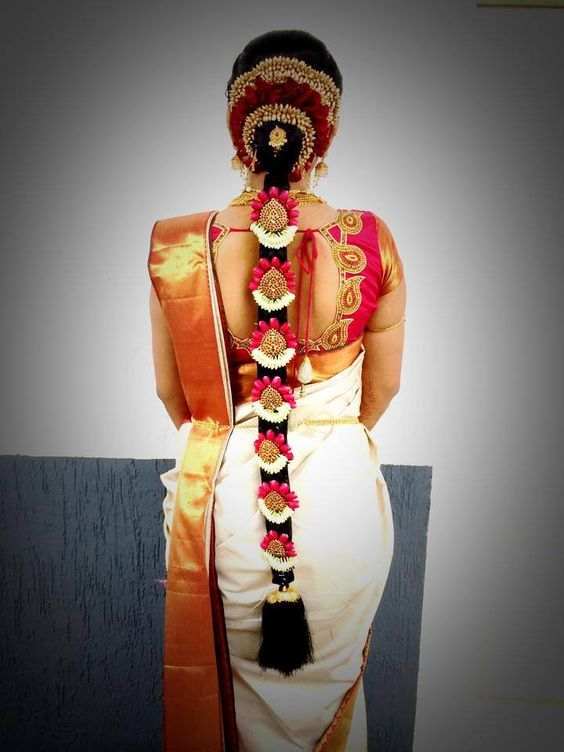 Traditional Southern Indian bride's bridal braid hair. Hairstyle by Swank Studio. Find us at https://www.facebook.com/SwankStudioBangalore   #Saree #Blouse #Design: