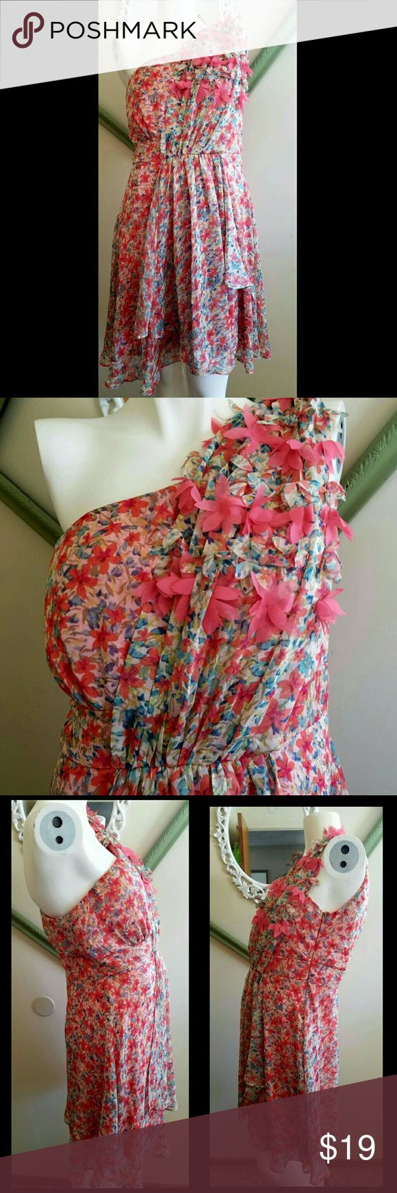 """One Shoulder Strap Dress. Gently loved. Colors: coral, peach, orange, green and blue. Zipper on the side. Lined. Has extra strip of fabric with coral flowers. Flowy. Below the knee. 100% polyester.   Measurements  Bust 37"""" - 38"""" Waist 29"""" - 30.5""""  Hip 39.5"""" - 41""""  Length 34.5"""" ( from top of strap to bottom) Inseam length 28.5"""" (underarm down to bottom)   Get an additional 30% off when purchasing 3 or more items using the bundle feature. Always willing to negotiate. Aniina Dresses One…"""