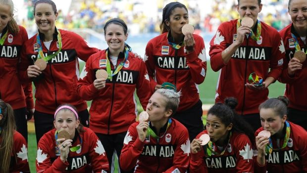 Canada celebrates bronze medal , The Canadian Press