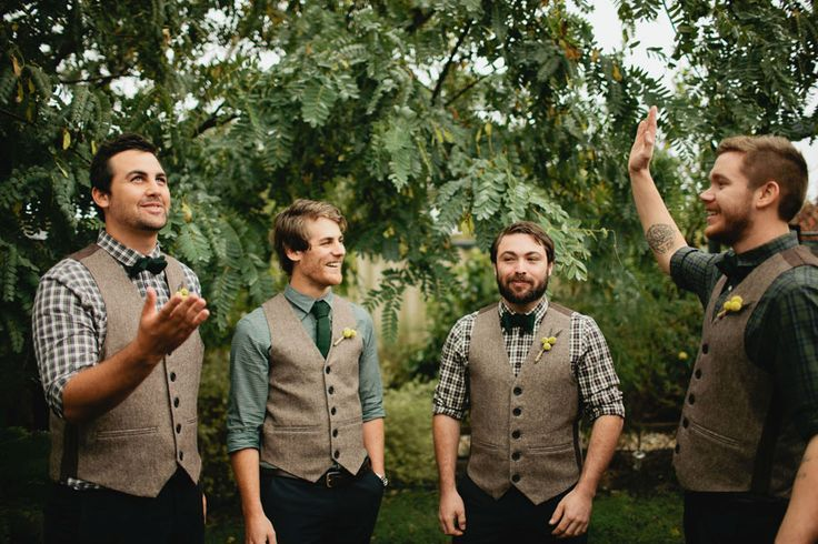 Groomsmen in tweed and green checked shirts.