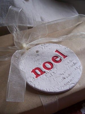 Noel using clay and stamping
