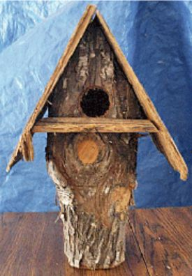 For a natural looking birdhouse, try making one from a hollow log. Some birds prefer these over manmade birdhouses. It's an easy project to do.