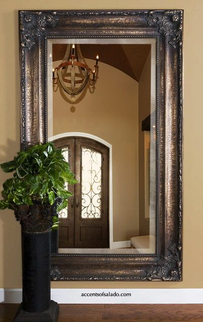 FLOOR MIRRORS.. Hanging a floor mirror on the wall at the end of the hallway - what a magnificent idea. ~Accents of Salado