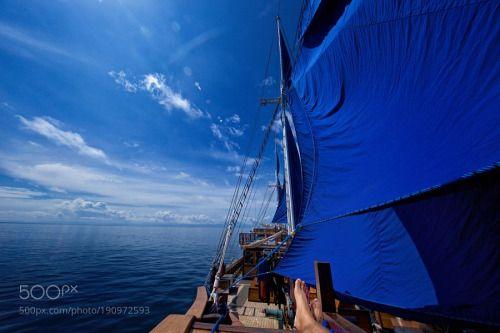 Sailing into 2017 by 500V4  sea boat sail blue ocean ship indonesia islands vessel sails Raja Ampat 500V4