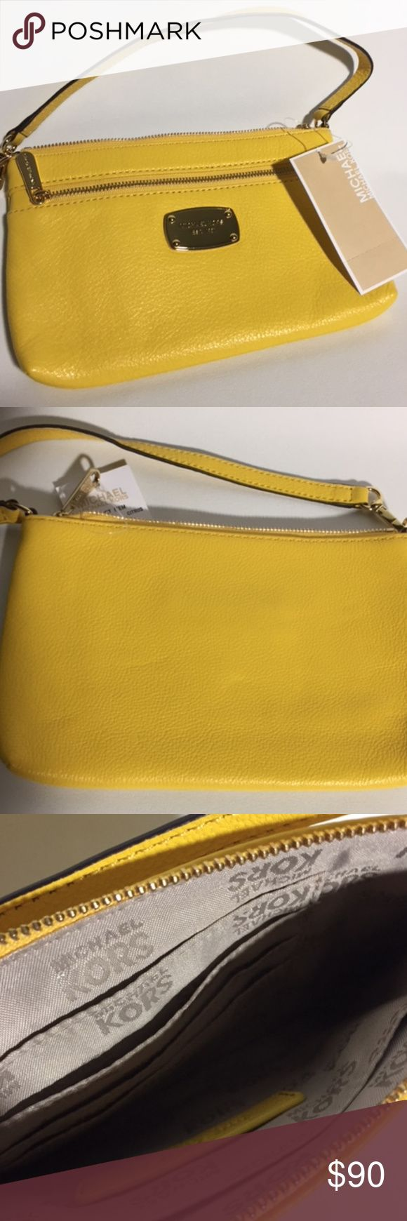 "NWT Michael Kors - Jet Set Large Wristlet - Citrus Can be transformed into a glamorous carry-on alone wristlet or an organizer that clips into a larger bag.  Features in Citrus – supple pebbled leather; lining: polyester;  Measures approximately: 8-1/2""W x 5""H x 1""D Detachable leather wrist/carry strap with 7"" drop  Top zip closure Gold-tone exterior hardware & 1 front zip pocket One interior slip pocket & card slots  Can be conveniently used for any occasion formal and informal dinners. It…"