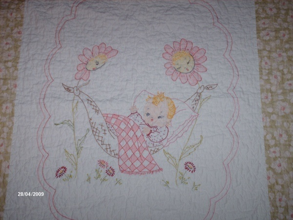 Embroidered baby quilt.  I made is one from a vintage pattern.