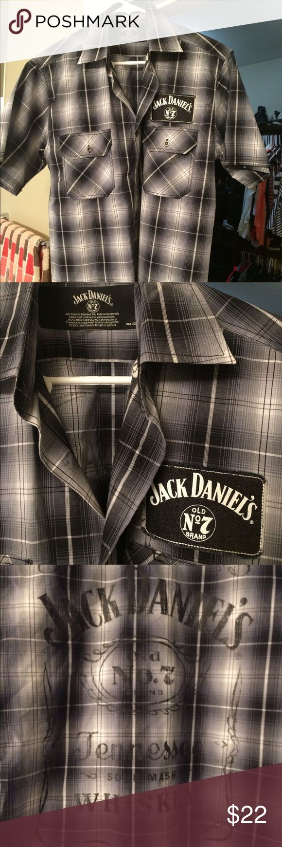 "Men's button up Jack Daniels plaid shirt Men's Large grey/blk/white official Jack Daniels button up shirt sleeve shirt. Never worn, perfect condition. Jack logo printed on back also. Front patch ""Jack Daniels"" on front Jack Daniels Tops Button Down Shirts"