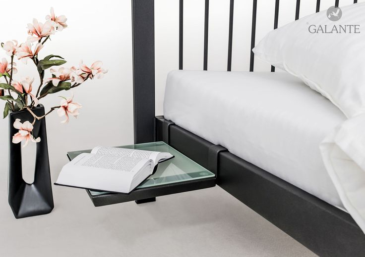 iron bed with bedside table