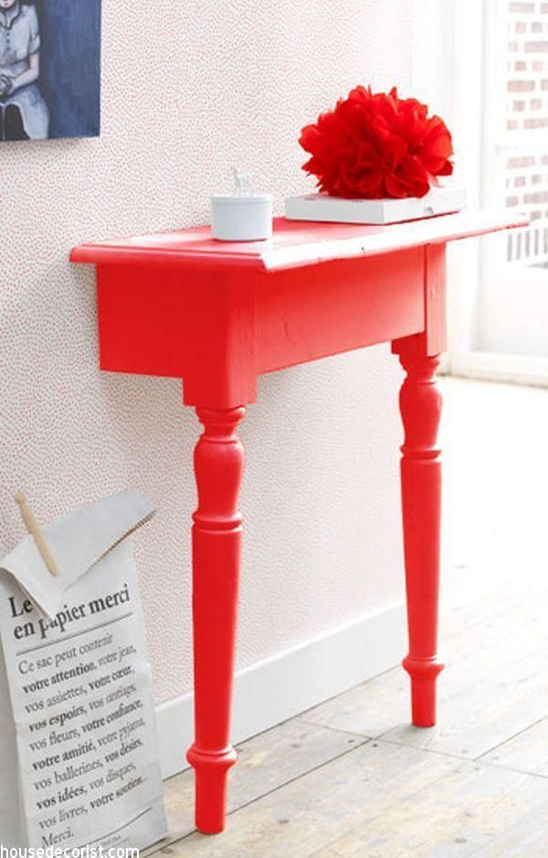 Brilliant! Table cut in half and painted a fabulous orange, using mounting brackets to stabilise. A great use of limited space.