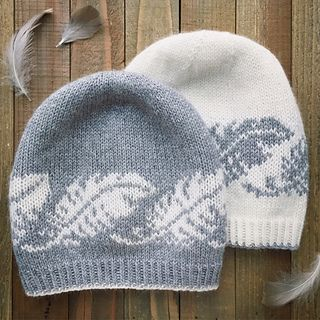 The Featherlight Beanie lives up to its name - light as a feather and impossibly soft - knit in Lux Adorna Knits' 100% Cashmere Sport Weight yarn. The beanie begins with a contrasting edge and crisp ribbing, and features an alternating feather motif that circles the body of the hat. The following pattern is recommended for intermediate-level knitters who have experience with stranded colorwork, reading from charts, and knitting in the round. The gray sample uses colorways Kitten (Main…