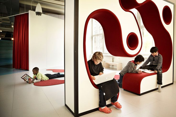 New Swedish School by Rosan Bosch. With no classroom walls, just colourful abstract furniture - which invites interaction and play.
