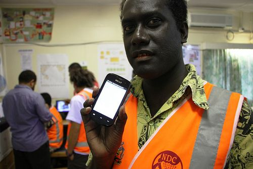 Principal Operation Officer Hotoravu Alenge showing the mobile emergency warning updates used for the first time during the Aelan Wev exercise