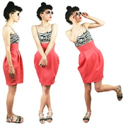 A model wears a salmon coloured version of the DIYcouture tulip skirt and strikes three poses.
