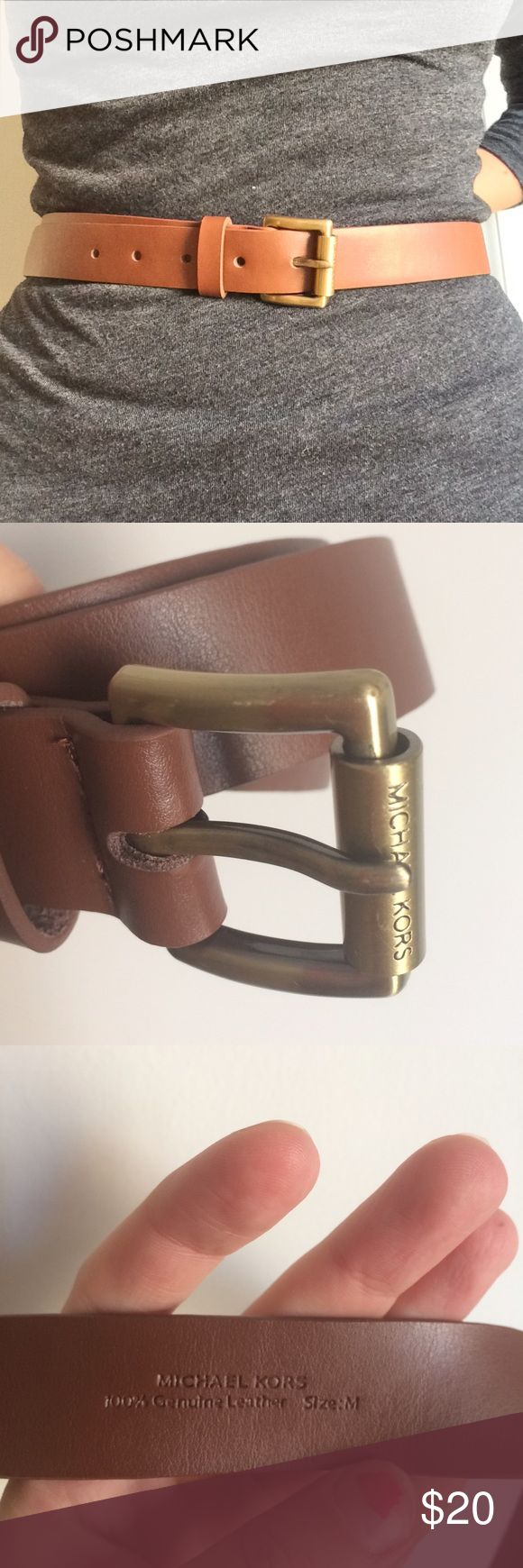 """Offers! Michael Kors Leather Brown Belt - Medium Authentic quality leather belt by Michael Kors. Band (without buckle) measures 45"""" long and just over 1"""" wide. Smallest hole makes it 29"""", largest hole is at 33"""" long. Some markings on buckle (2nd photo). Brass/gold tone buckle. A crease at the end of the belt/some crinkly due to storage (4th photo). Worn a couple of times. Ask questions! I want you to be happy with your purchase. Offers welcome! Michael Kors Accessories Belts"""