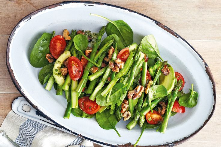 Asparagus, spin, avo & tom salad - Add some crunch to the table with this healthy, gluten-free summer salad.