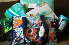 Silent Auction gift bag (Fun in the Sun). Thirty One Zip Top Organizing Tote,  Lawn Blanket,  Pool Lounger, Beach Towel,  Fan Spray Bottle,  Bubba Cup.  www.mythirtyone.com/470618
