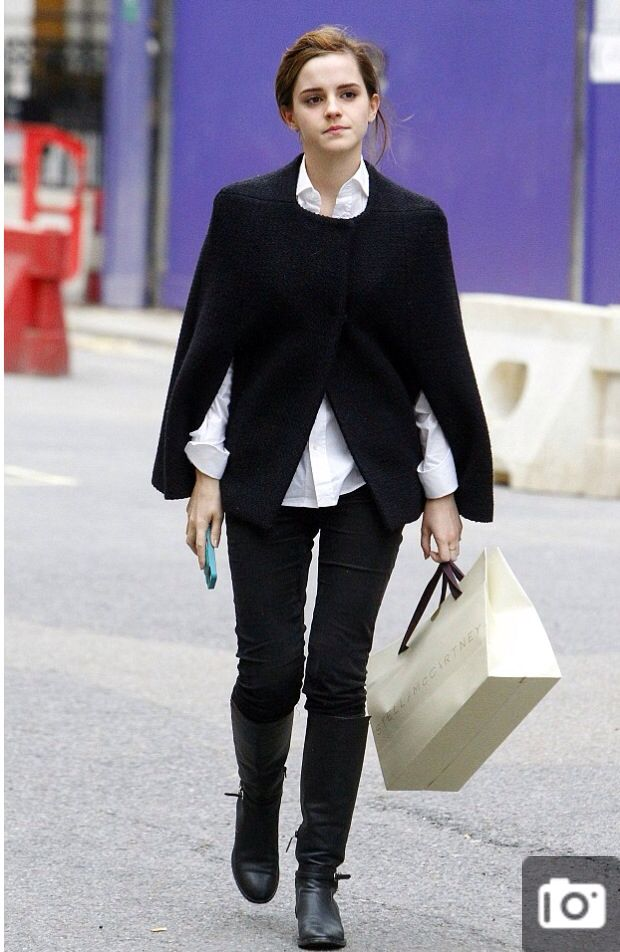 Emma Watson in a cape and riding boots out and about.