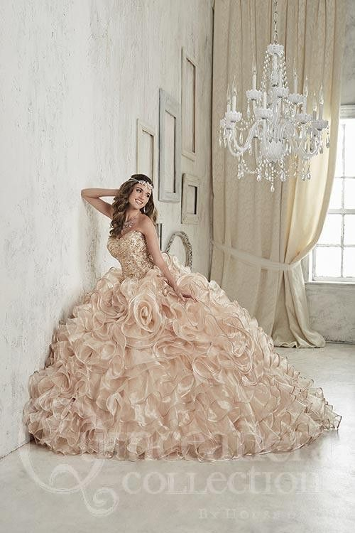 Crafted with thick clusters of colorful rhinestones on the sweetheart bodice, this gown brings together an enamoring mixture of ruffles and rosettes upon the skirt made with metallic organza and edged