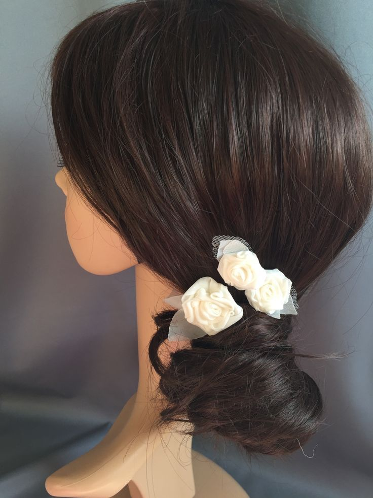 Dainty little ivory fabric roses on hairpins, these bridal hair pins are super versatile and can be placed in clusters, in line, or dotted about - not just for brides, they are also great for bridesmaids and flower girls.  #weddinghairpins #bridalhairpins #weddinginspiration #weddinghairideas