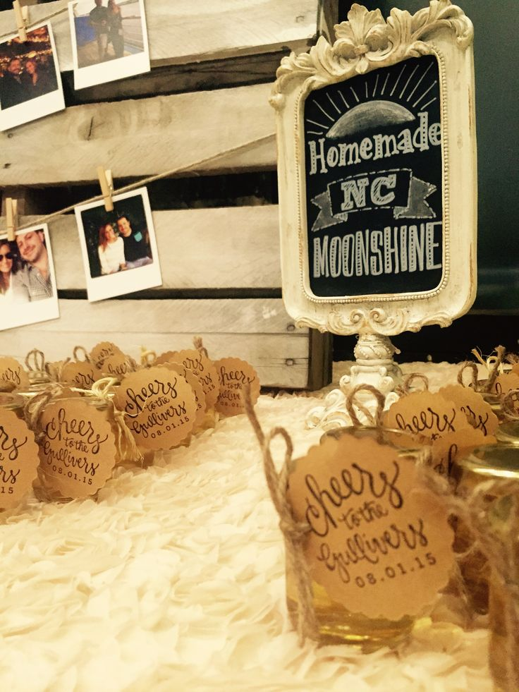 The homemade moonshine favors were a hit with these guests. Cheers to the Gullivers! #chalkbyjulie #chalkboardsbyjulie
