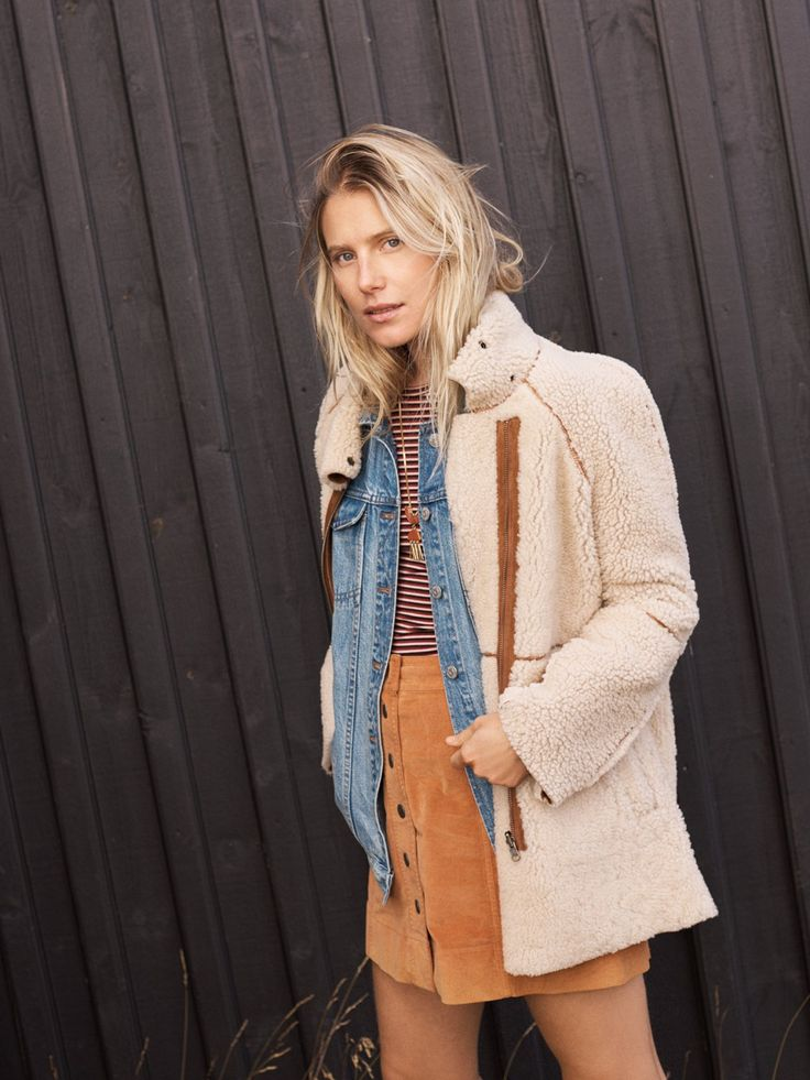 madewell reversible shearling jacket worn with the oversized jean jacket, long-sleeve bodysuit, velveteen skirt + concept pendant necklace.